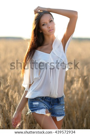 portrait of a beautiful sexy girl in summer field - stock photo