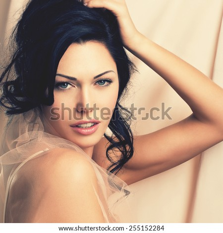 Portrait of a beautiful sexy tender woman with creative hairstyle. Model posing at studio - stock photo