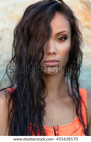 portrait of a beautiful sexy woman on the beach in summer - stock photo