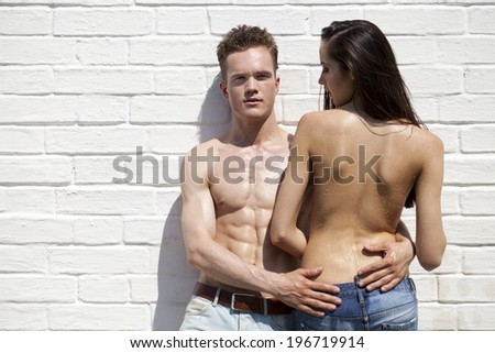 Portrait of a beautiful sexy young couple in blue jeans