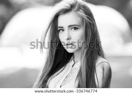 Portrait of a beautiful sexy young girl with perfect skin and make-up closeup. Emotional photo. Black and white - stock photo