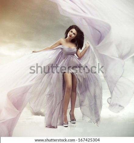 Portrait of a beautiful sexy young woman in violet dress  - stock photo