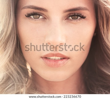 portrait of a beautiful sexy young woman with perfect skin and make-up closeup - stock photo