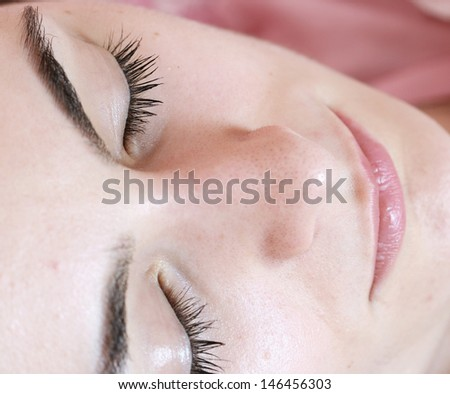 Portrait of a beautiful sleeping woman .