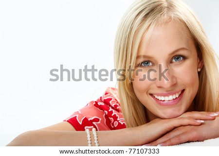 Portrait of a beautiful smiling blond looking at camera - stock photo