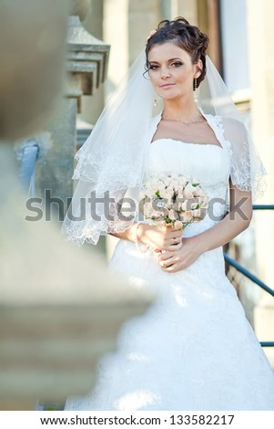 Portrait of a beautiful smiling bride