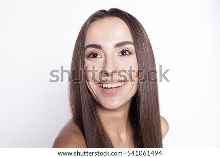 Portrait of a beautiful smiling brunette on a white background.