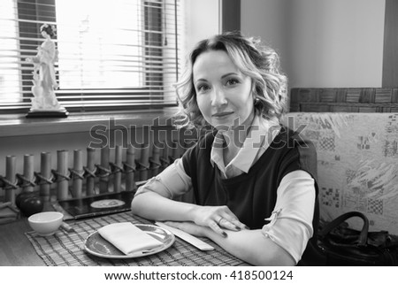 portrait of a beautiful smiling girl in a cafe black and white