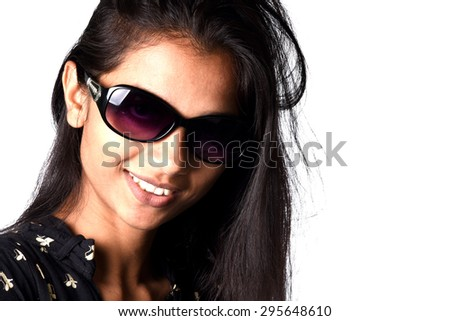 Portrait of a beautiful smiling girl in sunglasses on white background.