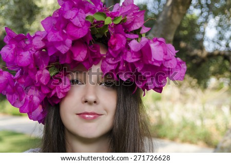 portrait of a beautiful smiling girl with a wreath flowers bougainvillea - stock photo