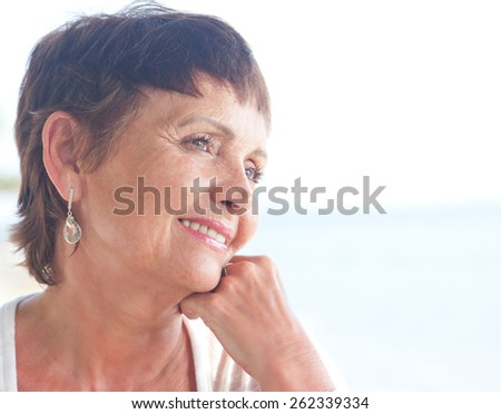 portrait of a beautiful smiling older woman - stock photo