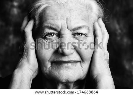 Portrait of a beautiful smiling senior woman.  - stock photo