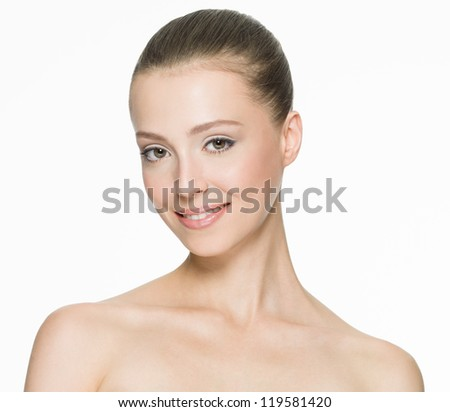 Portrait of a beautiful smiling woman with clean skin - isolated - stock photo