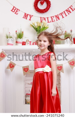 Portrait of a beautiful smiling young girl in a romantic setting on Holiday - stock photo
