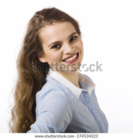 Portrait of a beautiful smiling young woman dressed in a blue shirt on a white background