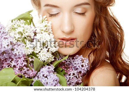 Portrait of a beautiful spring girl with lilac flowers. - stock photo