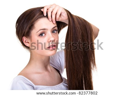 Portrait of a beautiful teen girl with long hairs and clean skin of the face - isolated on white