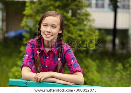 portrait of a beautiful teenage girl in a summer park. youth lifestyle