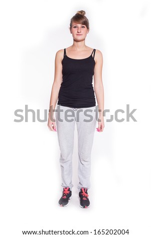 Portrait of a beautiful teenage girl in tracksuits with sports shoes isolated on white background. Studio shot.  Copy space. - stock photo