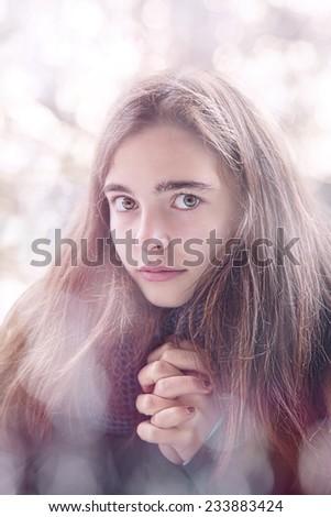 portrait of a beautiful teenage girl praying - stock photo
