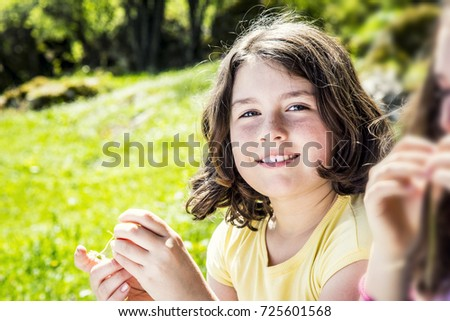 Portrait of a beautiful teenage girl smiling in the park