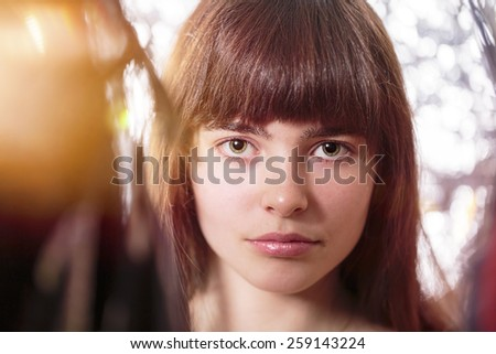 portrait of a beautiful teenage girl, with light leak and bokeh - stock photo