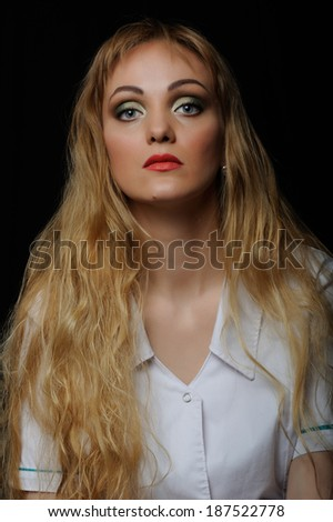 portrait of a beautiful  tired woman doctor - stock photo