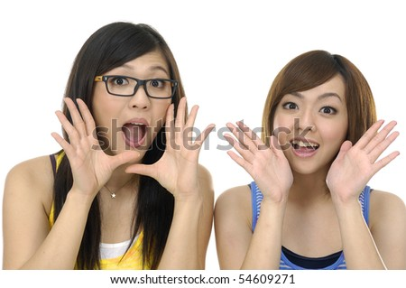 portrait of a beautiful two young excited woman against white background - stock photo