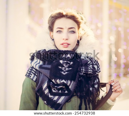 Portrait of a beautiful unusual girl in a green jacket with lights. close up - stock photo