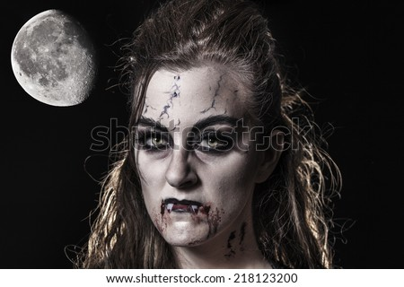 Portrait of a beautiful vampire. Halloween theme - stock photo