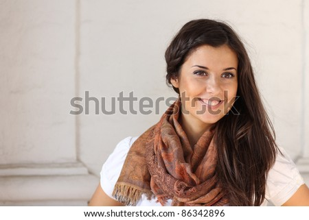 portrait of a beautiful woman against a white wall