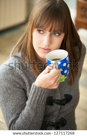 Portrait of a beautiful woman drinking coffee - stock photo