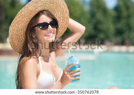 Portrait of a beautiful woman enjoying the summer - stock photo