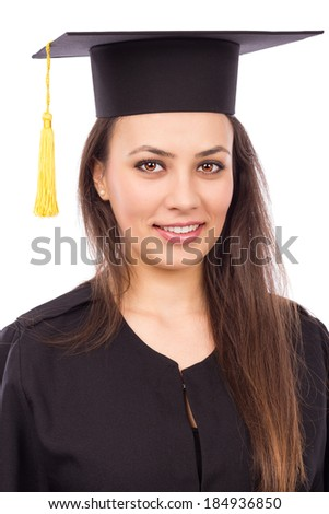 Portrait of a beautiful woman graduate wearing a graduation gown against white background - stock photo