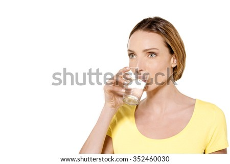 Portrait of a beautiful woman holding a glass of fresh water - stock photo