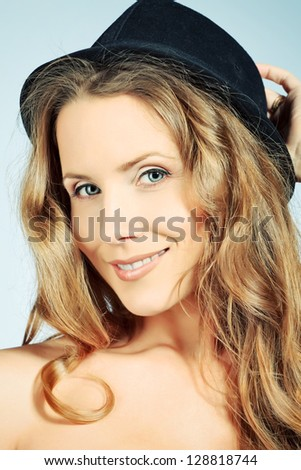 Portrait of a beautiful woman in a hat smiling at camera.