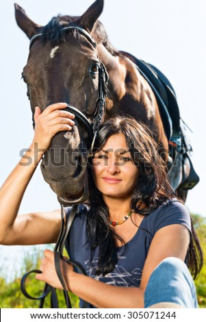 Portrait of a beautiful woman in a horse.