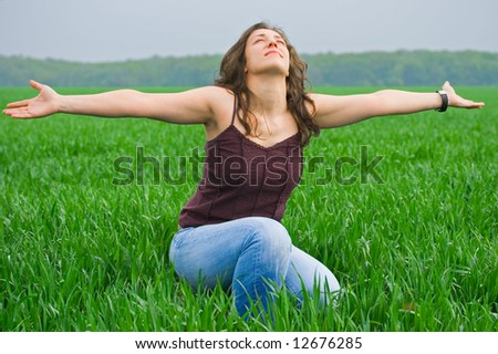 Portrait of a beautiful woman in a wheat field