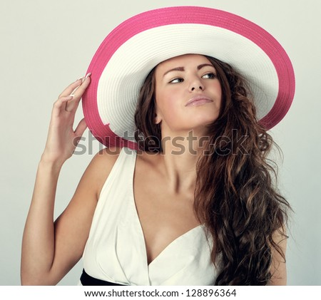 Portrait of a beautiful woman in a white hat from the sun. - stock photo