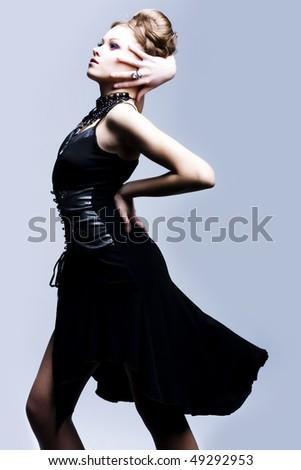 Portrait of a beautiful woman in black evening dress - stock photo