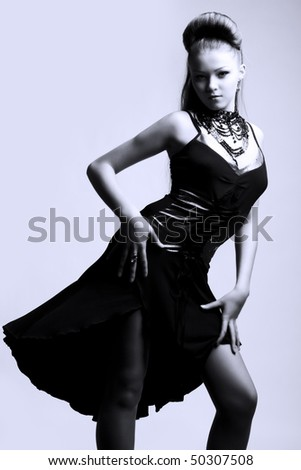 Portrait of a beautiful woman in black evening dress
