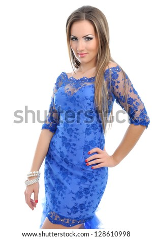 Portrait of a beautiful woman in blue dress - stock photo