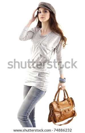 portrait of a beautiful woman in hat with handbag - stock photo
