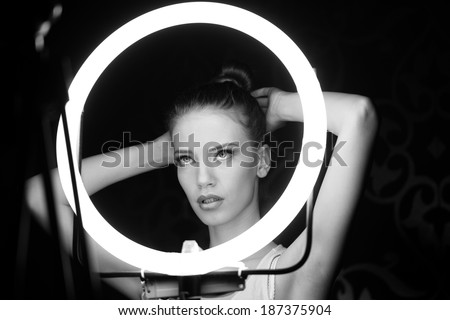 Portrait of a beautiful woman in the studio, backstage - stock photo