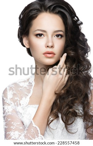 Portrait of a beautiful woman in  wedding dress in the image of the bride with flowers in her hair. Picture taken in the studio on a white background - stock photo