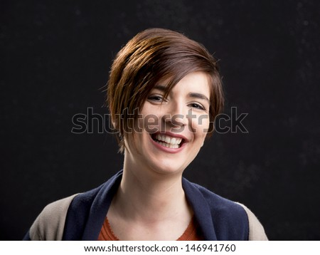 Portrait of a beautiful woman laughing and with a modern hair cut - stock photo