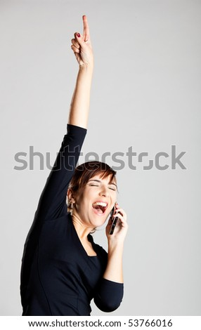 Portrait of a beautiful woman making a phone call and very happy with the good news - stock photo