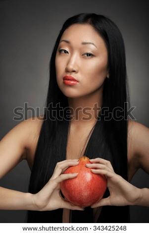 Portrait of a beautiful woman on black studio background - stock photo