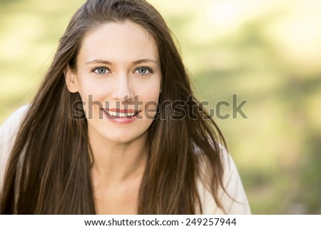 Portrait of a beautiful woman on green background - stock photo