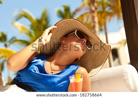 Portrait of a beautiful woman on vacation in luxury resort. Fresh pretty brunette in sunset light. Travel holidays vacation.  - stock photo